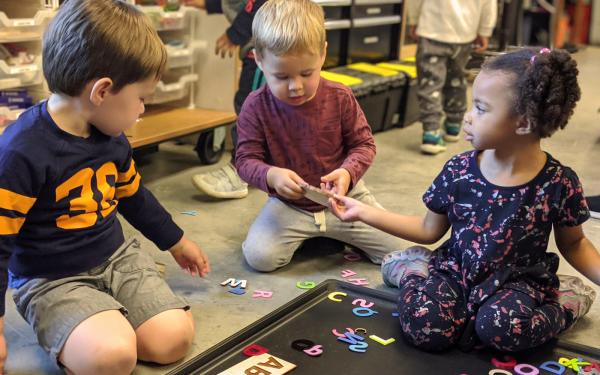3-year-old students work on an interactive activity