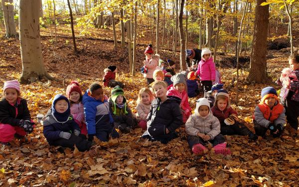 Group of PreK students learning outdoors