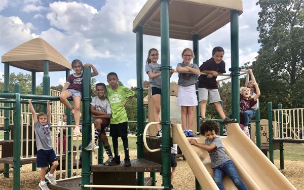 Group of Academy lower-school students on the playground