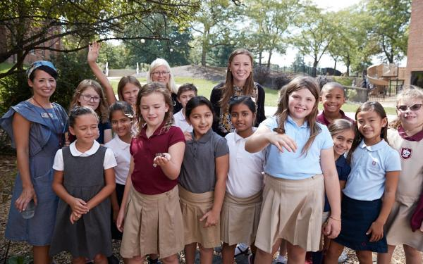 Columbus Academy lower school learning about butterflies outdoors