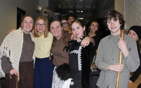 Columbus Academy middle school musical cast members backstage