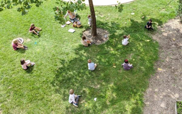 Students sitting on grass – outdoor class