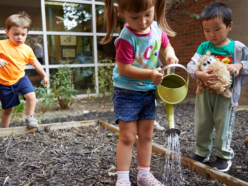 Lower school students watering the garden